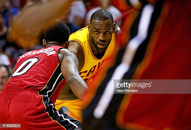 LeBron James of the Cleveland Cavaliers posts up Josh Richardson of the Miami Heat during a game at American Airlines Arena on March 19 2016 in Miami...