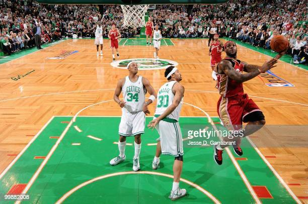 LeBron James of the Cleveland Cavaliers puts a shot up over Paul Pierce and Rasheed Wallace of the Boston Celtics in Game Six of the Eastern...
