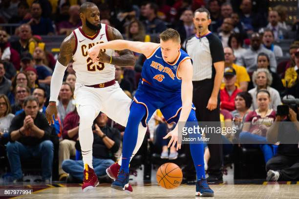LeBron James of the Cleveland Cavaliers puts pressure on Kristaps Porzingis of the New York Knicks during the second half at Quicken Loans Arena on...