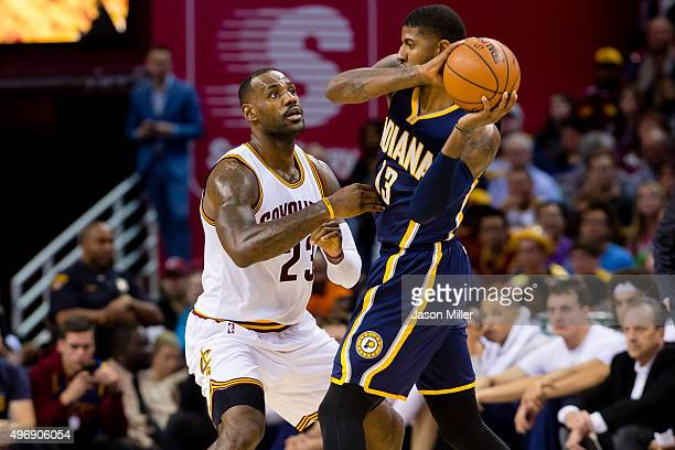 LeBron James of the Cleveland Cavaliers puts pressure on Paul George of the Indiana Pacers during the first half against the Indiana Pacers at...
