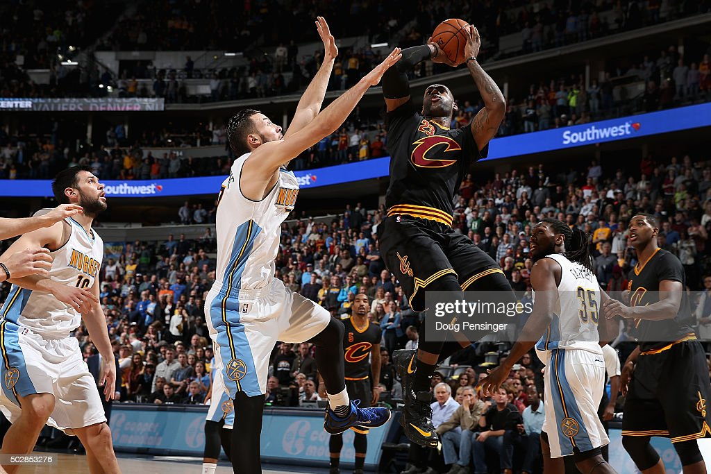 <a gi-track='captionPersonalityLinkClicked' href=/galleries/search?phrase=LeBron+James&family=editorial&specificpeople=201474 ng-click='$event.stopPropagation()'>LeBron James</a> #23 of the Cleveland Cavaliers puts up a shot against <a gi-track='captionPersonalityLinkClicked' href=/galleries/search?phrase=Joffrey+Lauvergne&family=editorial&specificpeople=6828069 ng-click='$event.stopPropagation()'>Joffrey Lauvergne</a> #77 of the Denver Nuggets at Pepsi Center on December 29, 2015 in Denver, Colorado.