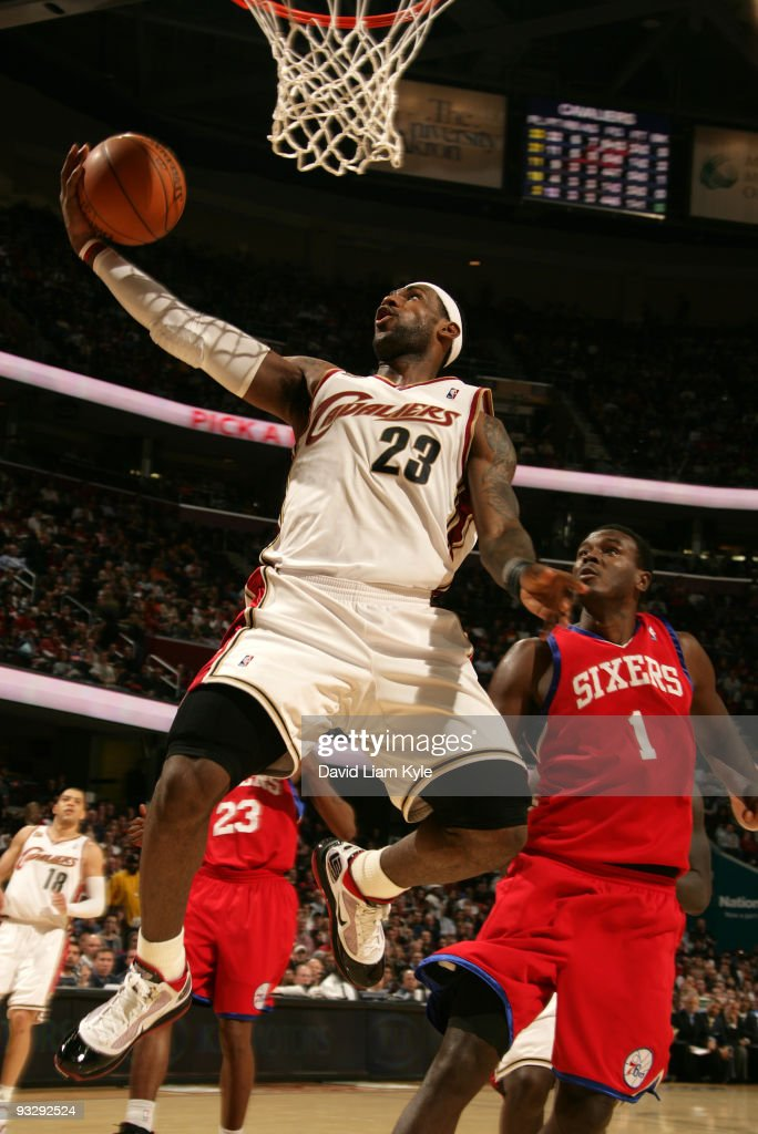 LeBron James of the Cleveland Cavaliers puts up the shot defended by Samuel Dalembert of the Philadelphia 76ers on November 21 2009 at The Quicken...