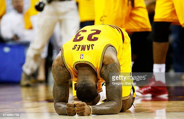 LeBron James of the Cleveland Cavaliers react after their 114 to 111 win over the Atlanta Hawks in overtime during Game Three of the Eastern...