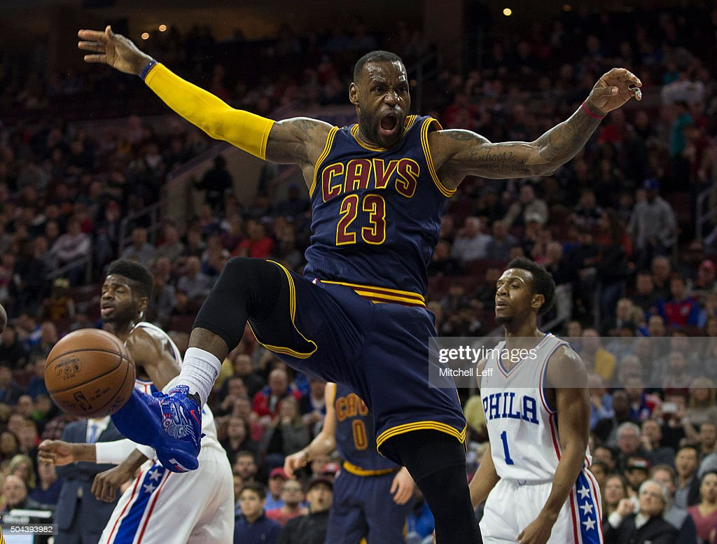 LeBron James of the Cleveland Cavaliers reacts after a dunk against the Philadelphia 76ers on January 10 2016 at the Wells Fargo Center in...