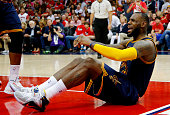 LeBron James of the Cleveland Cavaliers reacts after being called for his third foul in the third quarter against the Atlanta Hawks during Game One...