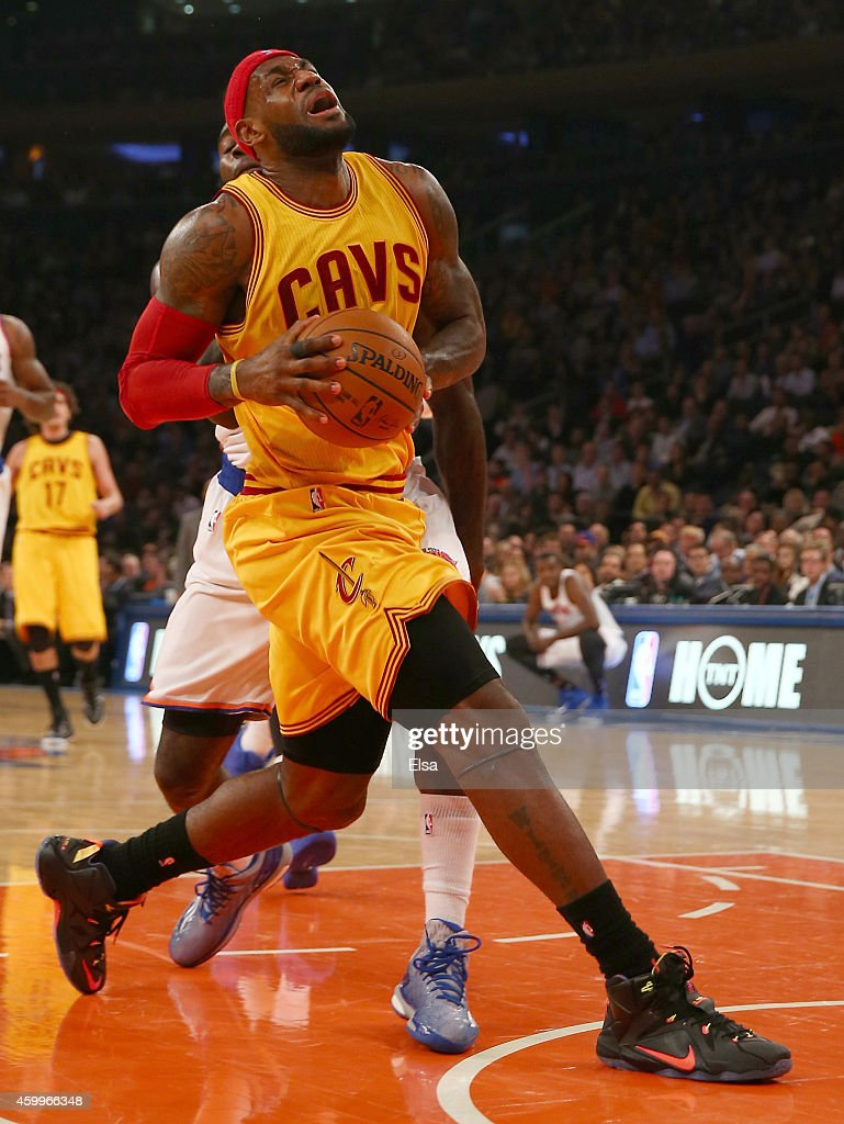 LeBron James #23 of the Cleveland Cavaliers reacts after he is fouled by Quincy Acy #4 of the New York Knicks at Madison Square Garden on December 4, 2014 in New York City.The Cleveland Cavaliers defeated the New York Knicks 90-87.NOTE