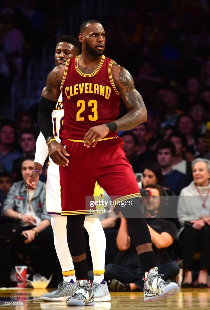 LeBron James #23 of the Cleveland Cavaliers reacts after his basket in front of David Nwaba #10 of the Los Angeles Lakers during a 125-120 Cavaliers win at Staples Center on March 19, 2017 in Los Angeles, California.
