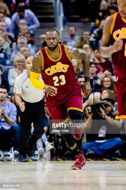 LeBron James of the Cleveland Cavaliers reacts after scoring during the first half against the New York Knicks at Quicken Loans Arena on February 23...