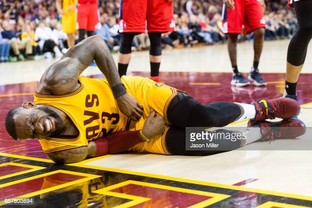 LeBron James of the Cleveland Cavaliers reacts after taking a hard hit during the second half against the Washington Wizards at Quicken Loans Arena...