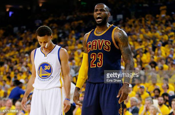 LeBron James of the Cleveland Cavaliers reacts as Stephen Curry of the Golden State Warriors looks on during Game Five of the 2015 NBA Finals at...