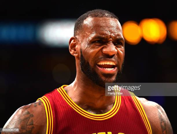 LeBron James of the Cleveland Cavaliers reacts during a 125120 win over the Los Angeles Lakers at Staples Center on March 19 2017 in Los Angeles...
