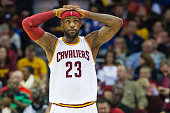 LeBron James of the Cleveland Cavaliers reacts during the first half against the Toronto Raptors at Quicken Loans Arena on November 22 2014 in...