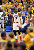 LeBron James of the Cleveland Cavaliers reacts during the first half against the Toronto Raptors in game two of the Eastern Conference Finals during...