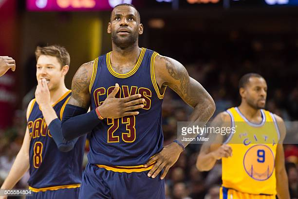 LeBron James of the Cleveland Cavaliers reacts during the second half against the Golden State Warriors at Quicken Loans Arena on January 18 2016 in...