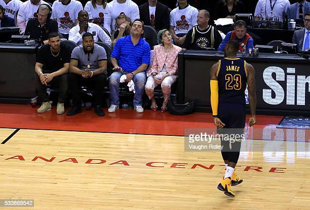 LeBron James of the Cleveland Cavaliers reacts in front of rapper Drake in the fourth quarter against the Toronto Raptors in game four of the Eastern...