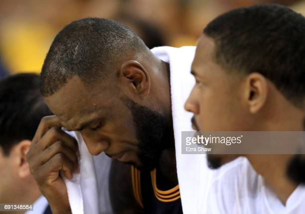 LeBron James of the Cleveland Cavaliers reacts on the bench during their 11390 loss in Game 1 of the 2017 NBA Finals against the Golden State...