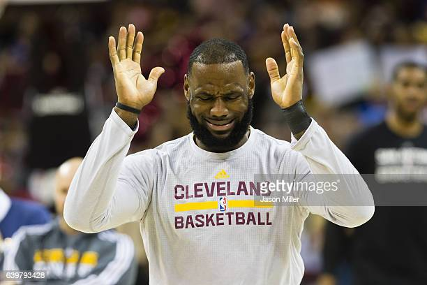 LeBron James of the Cleveland Cavaliers reacts while warming up prior to the game against the San Antonio Spurs at Quicken Loans Arena on January 21...