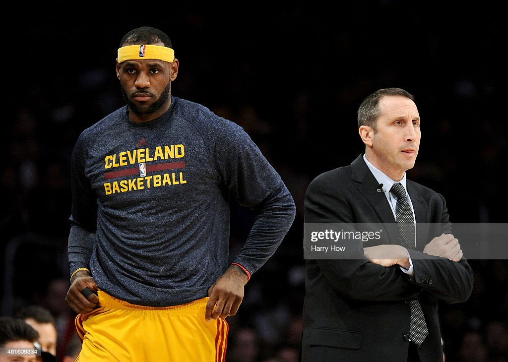 <a gi-track='captionPersonalityLinkClicked' href=/galleries/search?phrase=LeBron+James&family=editorial&specificpeople=201474 ng-click='$event.stopPropagation()'>LeBron James</a> #23 of the Cleveland Cavaliers returns to the court behind Head Coach <a gi-track='captionPersonalityLinkClicked' href=/galleries/search?phrase=David+Blatt&family=editorial&specificpeople=836616 ng-click='$event.stopPropagation()'>David Blatt</a> of the Cleveland Cavaliers during a 109-102 win over the Los Angeles Lakers at Staples Center on January 15, 2015 in Los Angeles, California.