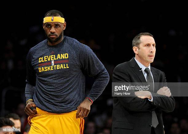 LeBron James of the Cleveland Cavaliers returns to the court behind Head Coach David Blatt of the Cleveland Cavaliers during a 109102 win over the...