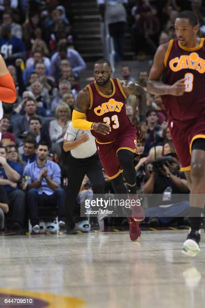 LeBron James of the Cleveland Cavaliers runs up court after scoring during the first half against the New York Knicks at Quicken Loans Arena on...