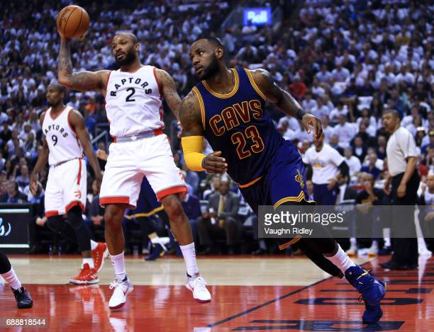 Lebron James of the Cleveland Cavaliers runs up the court as PJ Tucker of the Toronto Raptors defends in the first half of Game Four of the Eastern...