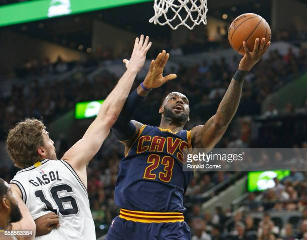 LeBron James of the Cleveland Cavaliers scores against Pau Gasol of the San Antonio Spurs at ATT Center on March 27 2017 in San Antonio Texas NOTE TO...