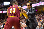 LeBron James of the Cleveland Cavaliers shakes hands with his former coach Erik Spoelstra of the Miami Heat during the first half at Quicken Loans...