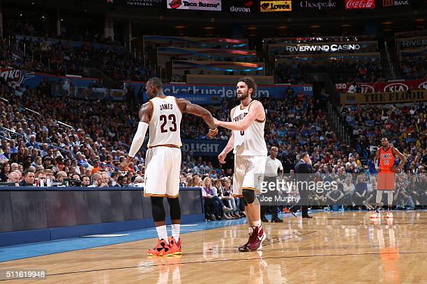 LeBron James of the Cleveland Cavaliers shakes hands with Kevin Love of the Cleveland Cavaliers during the game against the Oklahoma City Thunder on...