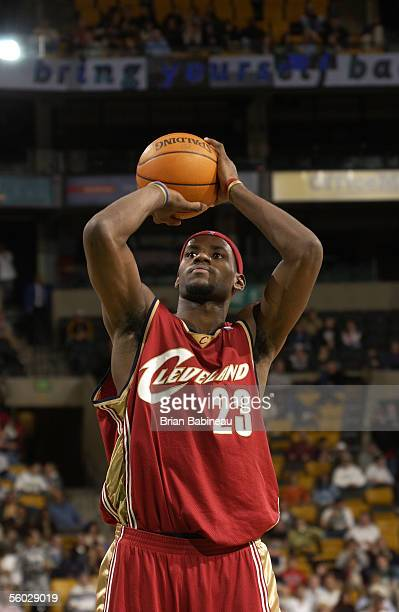 LeBron James of the Cleveland Cavaliers shoots a free throw attempt against the Boston Celtics during a preseason NBA game October 26 2005 at the TD...