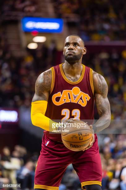 LeBron James of the Cleveland Cavaliers shoots a freethrow during the second half against the New York Knicks at Quicken Loans Arena on February 23...