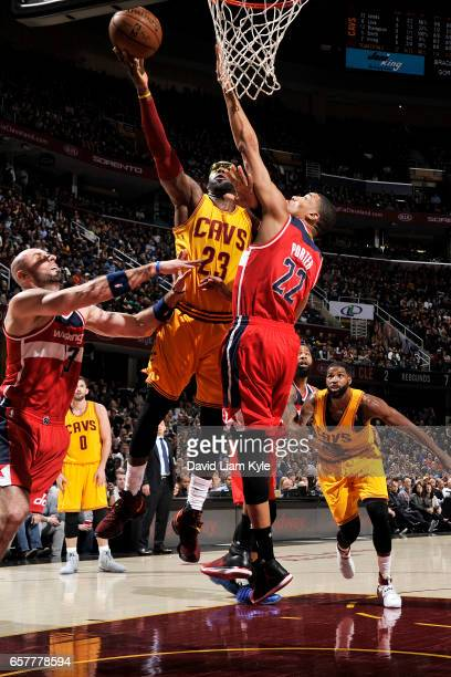 LeBron James of the Cleveland Cavaliers shoots a lay up during the game against the Washington Wizards on March 25 2017 at Quicken Loans Arena in...