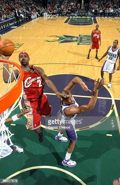 LeBron James of the Cleveland Cavaliers shoots a layup during the game with the Milwaukee Bucks on December 10 2005 at the Bradley Center in...