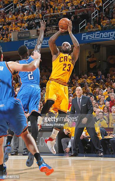 LeBron James of the Cleveland Cavaliers shoots against Anthony Morrow of the Oklahoma City Thunder on January 25 2015 at Quicken Loans Arena in...