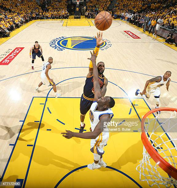 LeBron James of the Cleveland Cavaliers shoots against Draymond Green of the Golden State Warriors during Game Five of the 2015 NBA Finals on June 14...