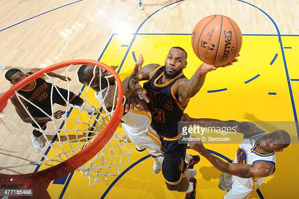 LeBron James of the Cleveland Cavaliers shoots against Draymond Green of the Golden State Warriors during Game Five of the 2015 NBA Finals at Oracle...