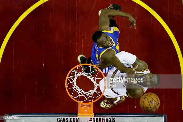 LeBron James of the Cleveland Cavaliers shoots against Draymond Green of the Golden State Warriors in the first half during Game Six of the 2015 NBA...