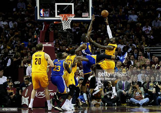 LeBron James of the Cleveland Cavaliers shoots against Festus Ezeli of the Golden State Warriors in the second quarter during Game Three of the 2015...