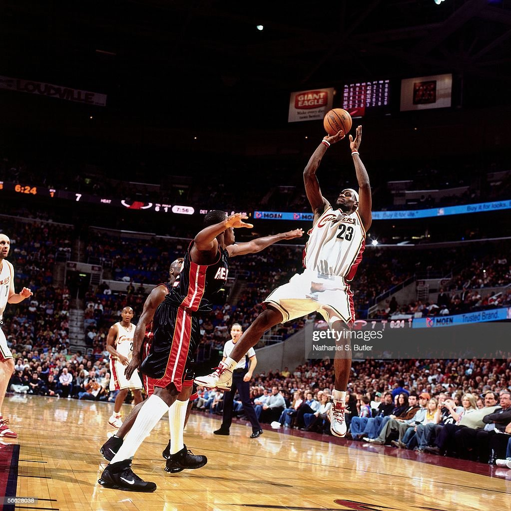 LeBron James #23 of the Cleveland Cavaliers shoots against James Posey #42 of the Miami Heat on December 17, 2005 at Quicken Loans Arena in Cleveland, Ohio.