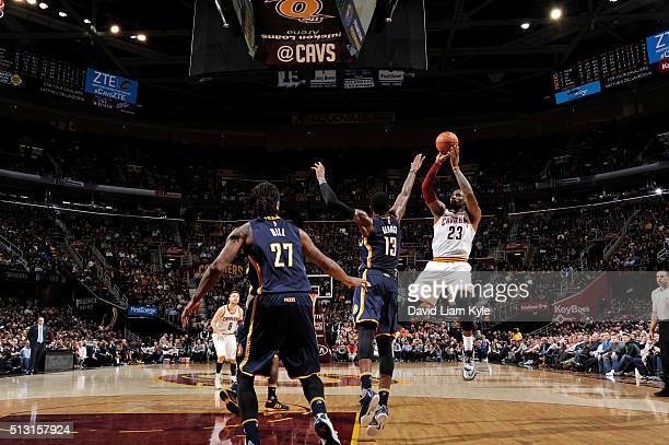 LeBron James of the Cleveland Cavaliers shoots against Paul George of the Indiana Pacers on February 29 2016 at Quicken Loans Arena in Cleveland Ohio...