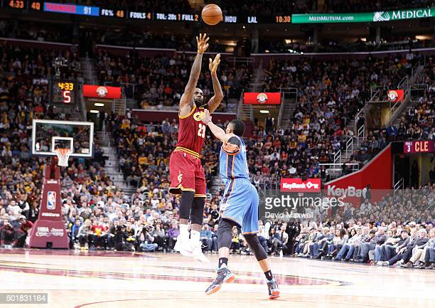 LeBron James of the Cleveland Cavaliers shoots against Russell Westbrook of the Oklahoma City Thunder during the second half of their game on...