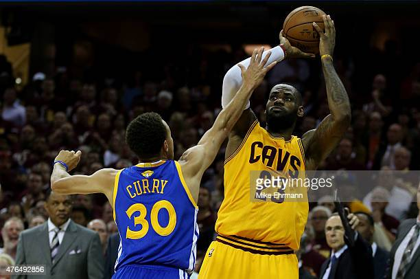 LeBron James of the Cleveland Cavaliers shoots against Stephen Curry of the Golden State Warriors in the fourth quarter during Game Three of the 2015...