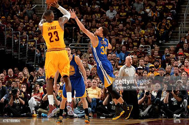 LeBron James of the Cleveland Cavaliers shoots against Stephen Curry of the Golden State Warriors during Game Four of the 2015 NBA Finals at The...