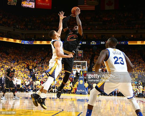 LeBron James of the Cleveland Cavaliers shoots against Stephen Curry of the Golden State Warriors in Game Seven of the 2016 NBA Finals on June 19...
