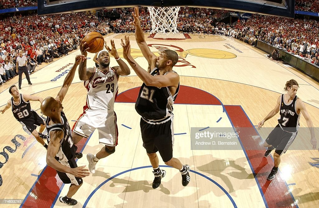 LeBron James #23 of the Cleveland Cavaliers shoots against Tim Duncan #21 of the San Antonio Spurs in Game Four of the 2007 NBA Finals at The Quicken Loans Arena on June 14, 2007 in Cleveland, Ohio.