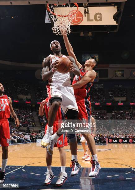 LeBron James of the Cleveland Cavaliers shoots against Yi Jianlian of the New Jersey Nets during the game on January 2 2010 at the Izod Center in...