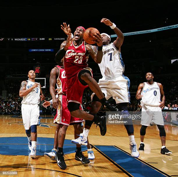 LeBron James of the Cleveland Cavaliers shoots and draws the foul against Andray Blatche of the Washington Wizards at the Verizon Center during the...