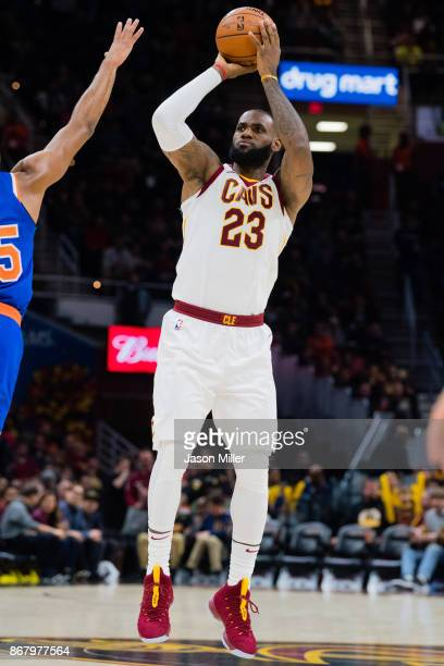 LeBron James of the Cleveland Cavaliers shoots during the second half at Quicken Loans Arena against the New York Knicks on October 29 2017 in...