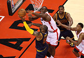 LeBron James of the Cleveland Cavaliers shoots in the third quarter against Bismack Biyombo of the Toronto Raptors in game four of the Eastern...