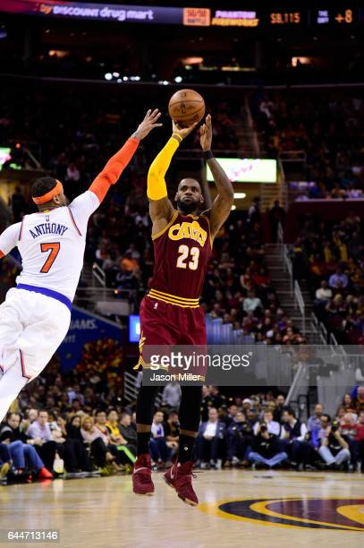 LeBron James of the Cleveland Cavaliers shoots over Carmelo Anthony of the New York Knicks during the second half at Quicken Loans Arena on February...