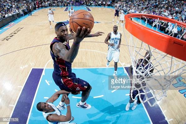 LeBron James of the Cleveland Cavaliers shoots over Chris Paul and Emeka Okafor of the New Orleans Hornets on March 24 2010 at the New Orleans Arena...